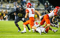 Braden Jay (5) of  Cabot runs ball as Cole Joyce (42) of  Bentonville squares to make the tackle at Tiger Stadium, Bentonville, Arkansas on Friday, November 20, 2020 / Special to NWA Democrat-Gazette/ David Beach