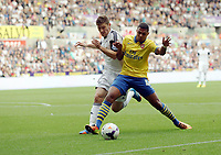Saturday 28 September 2013<br /> Pictured L-R: Ben Davies of Swansea challenging Serge Gnarby of Arsenal. <br /> Re: Barclay's Premier League, Swansea City FC v Arsenal at the Liberty Stadium, south Wales.