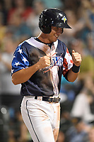 Designated hitter Colby Woodmansee (26) of the Columbia Fireflies pumps his fists after scoring a run in a game against the Rome Braves on Monday, July 3, 2017, at Spirit Communications Park in Columbia, South Carolina. Columbia won, 1-0. (Tom Priddy/Four Seam Images)