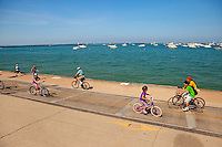 Boaters and bikers take in an enjoyable summer day on Lake Michigan near downtown Chicago, Ill.