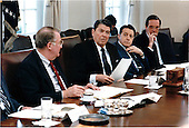 United States President Ronald Reagan meets with members of the Domestic Policy Council in the Cabinet Room of the White House on Tuesday, March 10, 1987.  Seated, from left, are: U.S. Attorney General Edwin Meese, III; President Reagan; U.S. Secretary of Defense Caspar Weinberger; and U.S. Secretary of Labor William Brock..Mandatory Credit: Terry Arthur - White House via CNP