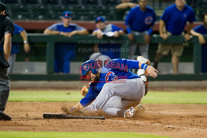 AZL Cubs third baseman Cam Balego (82) slides into home plate ahead of a tag by Ricardo Genoves (15) against the AZL Giants on September 5, 2017 at Scottsdale Stadium in Scottsdale, Arizona. AZL Cubs defeated the AZL Giants 10-4 to take a 1-0 lead in the Arizona League Championship Series. (Zachary Lucy/Four Seam Images)