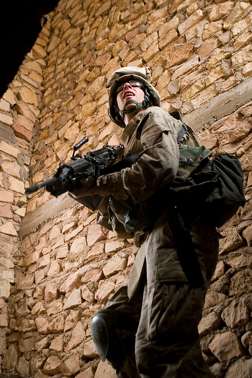 10 May 2007, Lance Cpl. Daniel Dalton from 2d Squad, 2d Platoon, Alpha Company, 1st Battalion, 2d Marine Regiment clears the second floor of a building in Ar Rutbah, Iraq. Marines with Alpha Company conduct security patrols to disrupt insurgents' capabilities to communicate. 1/2 is deployed with Multi National Forces-West in support of Operation Iraqi Freedom in the Al Anbar province of Iraq to develop Iraqi Security Forces, facilitate the development of official rule of law through democratic reforms, and continue the development of a market based economy centered on Iraqi reconstruction. (Official USMC photograph by Cpl. Shane S. Keller)