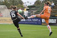Tiffeny Milbrett (15) kicks the ball against Megan Schnur (12). FC Gold Pride defeated Sky Blue FC 1-0 at Buck Shaw Stadium in Santa Clara, California on May 3, 2009.