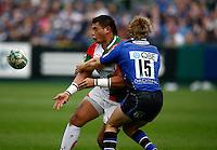 Photo: Richard Lane/Richard Lane Photography. Bath Rugby v Biarritz Olympique. Heineken Cup. 10/10/2010. Biarritz' Raphael Lakafia passes as he is tackled by Bath's Nick Abendanon.