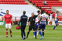 Match referee, Darren Bond, tells Reading's Yakou Meite, to leave the pitch at the nearest point and not walk across the grass to the West Stand during Charlton Athletic vs Reading, Sky Bet EFL Championship Football at The Valley on 11th July 2020