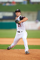 Arkansas Travelers pitcher Alan Busenitz (21) delivers a pitch during a game against the Corpus Christi Hooks on May 29, 2015 at Dickey-Stephens Park in Little Rock, Arkansas.  Corpus Christi defeated Arkansas 4-0 in a rain shortened game.  (Mike Janes/Four Seam Images)