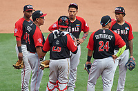 World Team manager Tony Perez (24) talks with infielders (L-R clockwise) Rafael Devers (3), Orlando Arcia (2), Raul Adalberto Mondesi (43), Cheslor Cuthbert (24), and Elias Diaz (29) during the MLB All-Star Futures Game on July 12, 2015 at Great American Ball Park in Cincinnati, Ohio.  (Mike Janes/Four Seam Images)