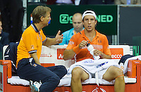 September 12, 2014, Netherlands, Amsterdam, Ziggo Dome, Davis Cup Netherlands-Croatia, Igor Sijsling (NED) on the Dutch bench with captain Jan Siemerink<br /> Photo: Tennisimages/Henk Koster