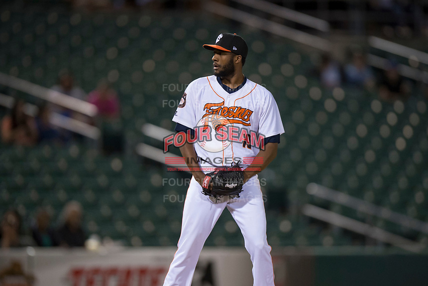 Fresno Grizzlies relief pitcher Reymin Guduan (19) prepares to deliver a pitch during a Pacific Coast League game against the Salt Lake Bees at Chukchansi Park on May 14, 2018 in Fresno, California. Fresno defeated Salt Lake 4-3. (Zachary Lucy/Four Seam Images)