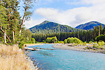 The powerful, famously blue, Hoh River charges down from the high Olympic Mountains. Olympic National Park.  Olympic Penninsula, Washington.  Outdoor Adventure.