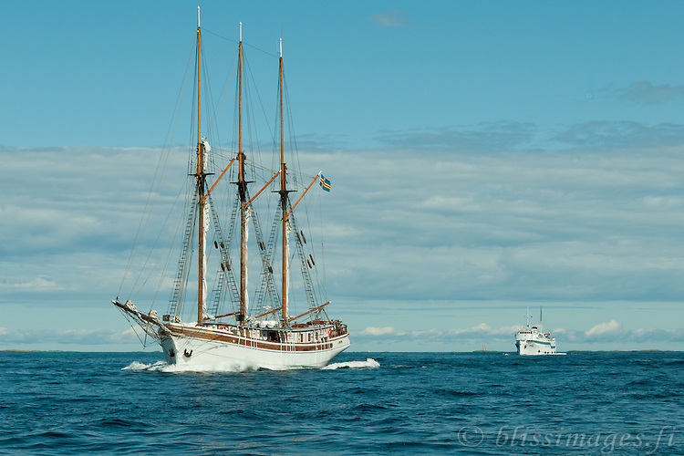 Schooner Linden of Åland leads Kristina Brahe cruise ship into the open Baltic Sea off the coast of Finland.