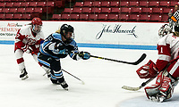 BOSTON, MA - JANUARY 04: Celine Tedenby #20 of University of Maine scores on Kate Stuart #1 of Boston University as Breanna Scarpaci #17 of Boston University pressures during a game between University of Maine and Boston University at Walter Brown Arena on January 04, 2020 in Boston, Massachusetts.