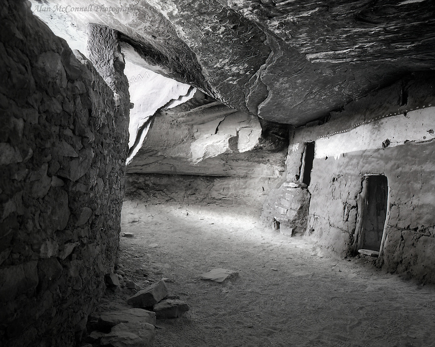"""""""The Moon House""""<br /> Cedar Mesa, Utah<br />  2011<br /> <br /> There are literally hundreds of ancient Puebloan ruins scattered around the four corners area, but one of the highest concentrations can be found on Cedar Mesa in Southeastern Utah.  One of the most fabulous sites is called the Moon House. <br /> The unique construction and pictographs causes this site to stand out from others.  The cliff dwelling has both an inner and outer section, with the center room decorated in white, with a crescent moon on one wall, and a full moon on the opposing wall.  The ruins acquired its name from these pictographs.  <br /> <br /> 4 x 5 Large Format Film"""