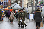 Army jog into town carrying large log collecting for the Gary Kelly Centre<br /> <br /> Picture Newsfile | Fran Caffrey