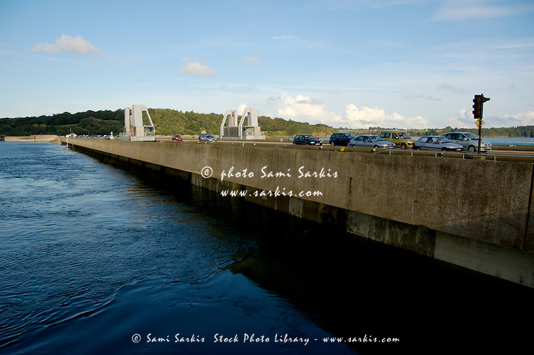 Cars crossing the dike over the river estuary, La Rance Valley, Brittany, France.