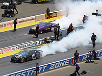 Jul 29, 2018; Sonoma, CA, USA; NHRA pro stock driver Tanner Gray (left) does a burnout alongside Vincent Nobile during the Sonoma Nationals at Sonoma Raceway. Mandatory Credit: Mark J. Rebilas-USA TODAY Sports