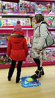 Pictured: A young girl and her mother browse in the Barbie section of the Toys R Us store in Swansea, Wales, UK. Wednesday 28 February 2018<br /> Re: Toys R Us have announced that they are in administration by Moorfields.