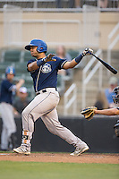 Hamlet Marte (14) of the Asheville Tourists follows through on his swing against the Kannapolis Intimidators at Intimidators Stadium on May 28, 2016 in Kannapolis, North Carolina.  The Intimidators defeated the Tourists 5-4 in 10 innings.  (Brian Westerholt/Four Seam Images)