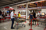 Costco Wholesale Corp. members wait in line at the food court in a newly opened Costco warehouse in Villebon-Sur-Yvette, France, on Saturday, July 7, 2018. The 150,000-square foot warehouse, which opened last month just outside of Paris, is Costco's first store in France. Costco plans to open 15 more warehouses in France by 2025. Photograph by Michael Nagle