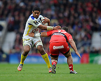 Fritz Lee of ASM Clermont Auvergne goes past Alexandre Menini of RC Toulon
