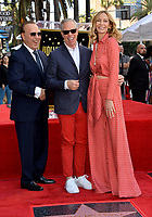LOS ANGELES, CA. October 10, 2019: Tommy Mottola, Tommy Hilfiger & Dee Ocleppo Hilfiger  at the Hollywood Walk of Fame Star Ceremony honoring Tommy Mottola.<br /> Pictures: Paul Smith/Featureflash
