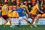 Motherwell v St Johnstone...31.01.15    SPFL<br /> Chris Kane is closed down by Fraser Kerr<br /> Picture by Graeme Hart.<br /> Copyright Perthshire Picture Agency<br /> Tel: 01738 623350  Mobile: 07990 594431