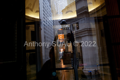 New York, New York<br /> USA<br /> February 21, 2011<br /> <br /> The President George Washington statue reflex in the window of the Federal Hall on snowy President's day.