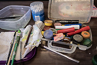 Facepaints lie on a table backstage during a performance by the Cape Town college of Magic at the Artscape Theatre.