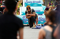 Summer Lee kneels during a 'March for Juneteenth: Direct Action' demonstration takes place from Wilkinsburg to Mellon Park on Friday June 19, 2020 in Pittsburgh, Pennsylvania. (Photo by Jared Wickerham/Pittsburgh City Paper)