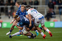 3rd October 2021; AJ Bell stadium, Eccles, Greater Manchester, England: Gallagher Premiership Rugby, Sale v Exeter ; Don Armand of Exeter Chiefs tackles Cobus Weise of Sale Sharks