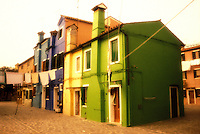 Italy, Island of Burano. Colorful homes with laundry hanging. One of the Islands near Venice
