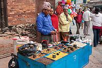 Nepal, Patan.  Street Vendor of Snacks, Nuts, Popcorn.