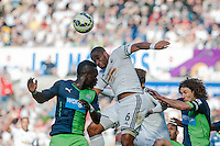 Saturday 4th  October 2014 Pictured: Ashley Williams  ( 6 ) of Swansea City jumps for the ball <br /> Re: Barclays Premier League Swansea City v Newcastle United at the Liberty Stadium, Swansea, Wales,UK