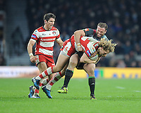 Billy Twelvetrees of Gloucester Rugby lis wrapped up by Jamie Roberts of Harlequins during the Aviva Premiership Rugby match between Harlequins and Gloucester Rugby at Twickenham Stadium on Tuesday 27th December 2016 (Photo by Rob Munro/Stewart Communications)