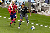 ST PAUL, MN - SEPTEMBER 9: Emanuel Reynoso #10 of Minnesota United FC and Michael Barrios #21 of FC Dallas battle for the ball during a game between FC Dallas and Minnesota United FC at Allianz Field on September 9, 2020 in St Paul, Minnesota.