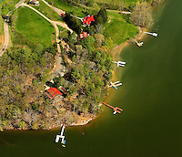 Aerial photography of and around Watauga Lake, Tenn., taken April 2011. Surrounded by the Cherokee National Forest, the vast majority of Watauga Lake's shoreline and surrounding mountains is undeveloped and pristine. Even during busy holiday weekends (photo taken on Easter weekend 2011) the large lake is rarely busy with boaters. Photo shows bridge near Pioneer Landing Marina and cove that is home to Whipkins Cove (vacation rental home - red roof).