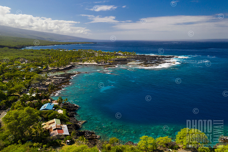 An aerial view of Pu'uhonua o Honaunau, or City of Refuge, an historic Hawaiian place of refuge and also a national historic landmark on the Big Island; Two Step dive and snorkeling area can be seen near it in Honaunau Bay.