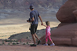 Father and daughter at Arches National Park, Moab, Utah, USA. .  John offers private photo tours in Arches National Park and throughout Utah and Colorado. Year-round.