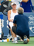 Caroline Wozniack (DEN) talks to her coach (and father) during her match against Serena Williams (USA). Wozniacki fell to Serena by 26 62 64 at the Western & Southern Open in Mason, OH on August 16, 2014.