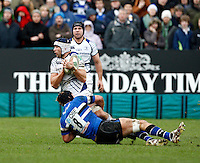 Photo: Richard Lane/Richard Lane Photography. Bath Rugby v Leinster. Heineken Cup. 11/12/2011. Leinster's Kevin McLaughlin is tackled by Bath's Simon Taylor.