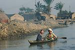Marsh Arabs. Southern Iraq. Marsh Arab men in boat banks of river Tigris. Haur al Mamar or Haur al-Hamar marsh collectively known now as Hammar marshes Irag 1984