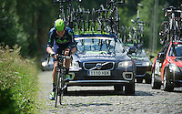 Alex Dowsett (GBR) biting through the pain 25km after crashing hard (and dislocating both thumbs) up the cobbled 17% section of the Mont Saint Laurent<br /> <br /> Eneco Tour 2013<br /> stage 2: Ardooie - Vorst (Brussel)<br /> 177km