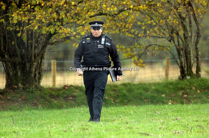 Pictured: A police officer at the the property in Llangammarch Wells, Powys, Wales, UK. Tuesday 31 October 2017<br />Re: Investigations continue into a house fire in which a father and several of his children have died.<br />Three children aged 13, 12 and 10 escaped the farmhouse in Llangammarch Wells, Powys, in the early hours of Monday and raised the alarm.<br />Police said they could not identify the deceased or confirm numbers.<br />One of those missing has been named locally as David Cuthbertson.