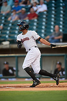Birmingham Barons left fielder Eloy Jimenez (21) hits a home run in the bottom of the first inning during a game against the Pensacola Blue Wahoos on May 8, 2018 at Regions FIeld in Birmingham, Alabama.  Birmingham defeated Pensacola 5-2.  (Mike Janes/Four Seam Images)