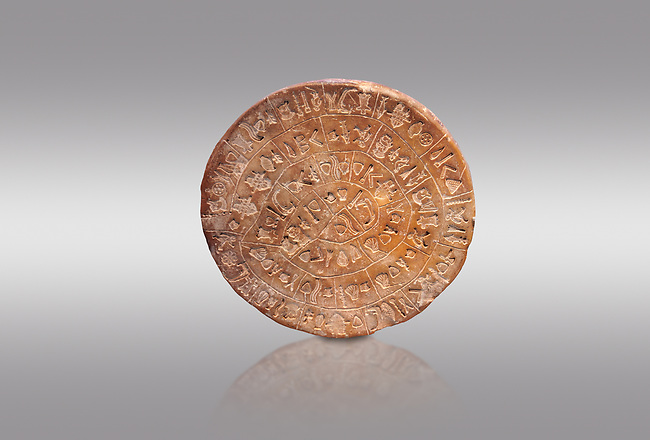 """The Minoan ' Phaistos Disc"""" with minoan pictoral sign script, possibly a hymn , Phaistos Palace 17th cent BC; Heraklion Archaeological  Museum, grey background.<br /> <br /> The enigmatic Phaistos disc takes pride of place in the history of Minoan script. It bears 45 pictoral signs that can be arranged into 61 groups separated by incised lines. Experts believe that the script may be of a hymn or magical in content."""