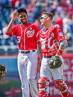 21 June 2015: Washington Nationals pitcher Felipe Rivero smiles with catcher Jose Lobaton after the final out against the Pittsburgh Pirates in the 9th inning at Nationals Park in Washington, DC. The Nationals defeated the Pirates 9-2 to sweep their 3-game weekend series, and improve their record to 37-33. Mandatory Credit: Ed Wolfstein Photo *** RAW (NEF) Image File Available ***