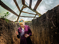 Natalia Voronkova, a volunteer who offers support and basic first aid training for Ukrainian government forces fighting Russian-backed separatists in the east of the country, walks through a trench in a frontline position. The situation is tense here, with mortar attacks and snipers ready to fire at their next target if the soldiers do not stay under cover.<br /><br />Natalia Voronkova says she hasn't worn jeans since 2014, and it's a statement for her to insist on wearing long dresses and high heels, even while walking in the trenches. She believes that her clear civilian appearance will protect her from snipers, but she also thinks that it brings a message of normality to the Ukrainian soldiers. It encourages them to not give up, if she can walk here in such clothes they might also find the strength to carry on under such hard living conditions.