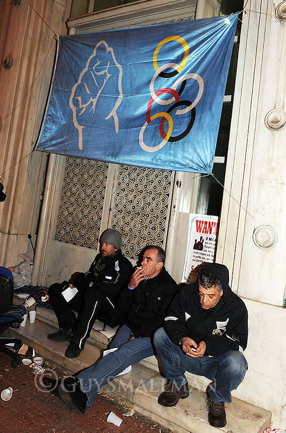 Sacked Olympic Airlines workers occupy a finance ministry building and block the road outside. 10-3-10