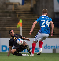 Milton Keynes Dons' Louis Thompson (left) vies for possession with Portsmouth's Michael Jacobs<br /> <br /> Photographer David Horton/CameraSport<br /> <br /> The EFL Sky Bet League One - Portsmouth v Milton Keynes Dons - Saturday 10th October 2020 - Fratton Park - Portsmouth<br /> <br /> World Copyright © 2020 CameraSport. All rights reserved. 43 Linden Ave. Countesthorpe. Leicester. England. LE8 5PG - Tel: +44 (0) 116 277 4147 - admin@camerasport.com - www.camerasport.com